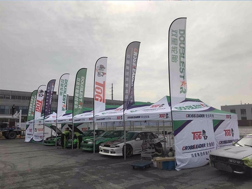 company cases about TLF Advertising Company Produced Many Custom Printed Canopies and Flag FOR  Racing Comany